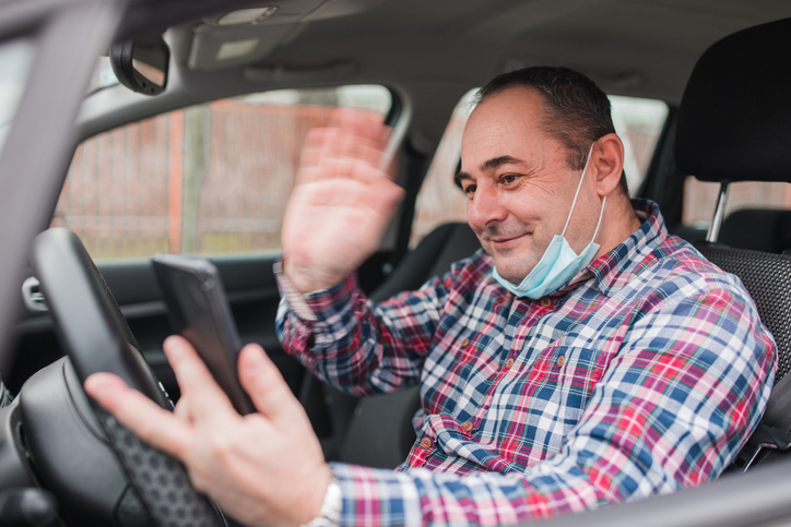 A male driver looking at his phone